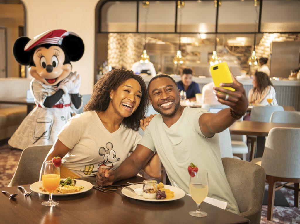 Couple eating breakfast at Disney's Riviera Resort